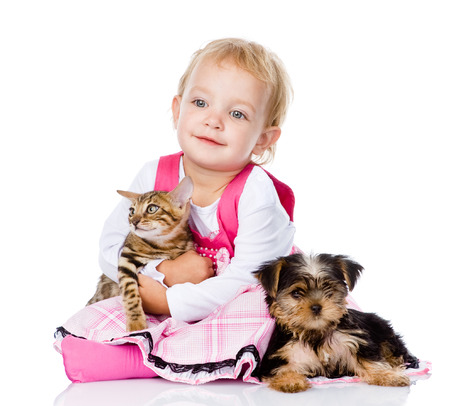 animal related: girl playing with pets - dog and cat  looking away  isolated on white background Stock Photo