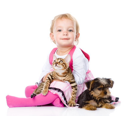 animal related: girl playing with pets - dog and cat  looking at camera  isolated on white background