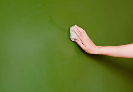 hand wipes the chalkboard, with a rag photo