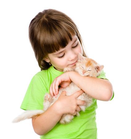 animal related: little girl hugging kitten  isolated on white background