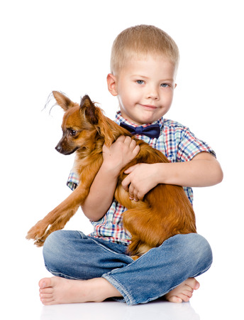 little boy hugging a dog  isolated on white background photo