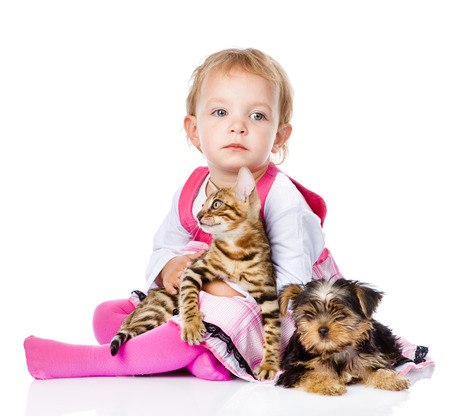 girl with pets - dog and cat  looking away  isolated on white background photo