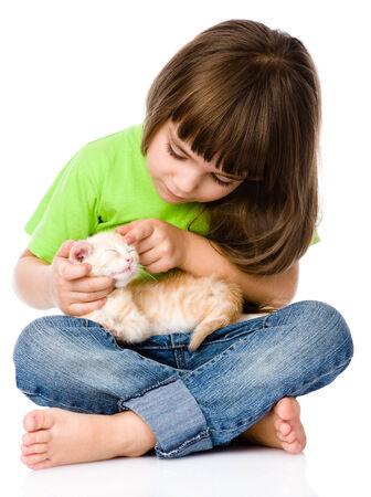 little girl stroking kitten  isolated on white background