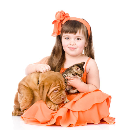 happy girl and her pets - a dog and a kitten  isolated on white background photo