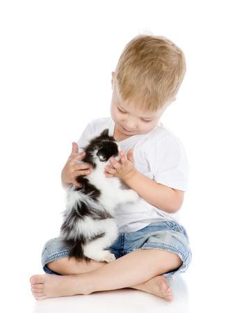animal related: little boy hugging kitten  isolated on white background
