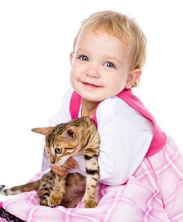 ittle: happy ittle girl hugging kitten  isolated on white background
