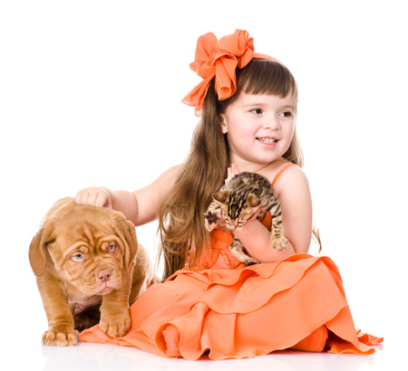 girl playing with cat and dog  isolated on white background photo