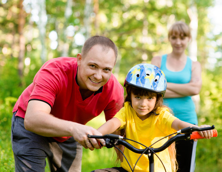 sports family having fun in the forest photo