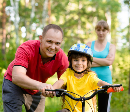 Family on cycle ride In forest photo