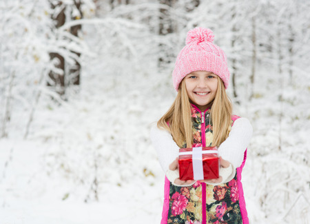 happy young  girl with red gift box photo