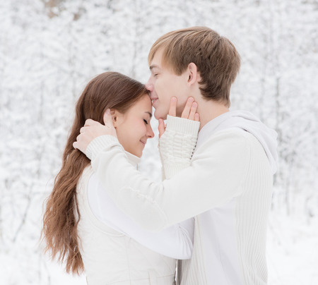 kiss couple: Young boy kisses a girl n forehead Stock Photo