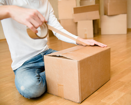 porter house: Close up of person hands packing cardboard box