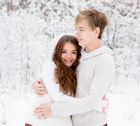 teen couple: happy sweethearts embracing