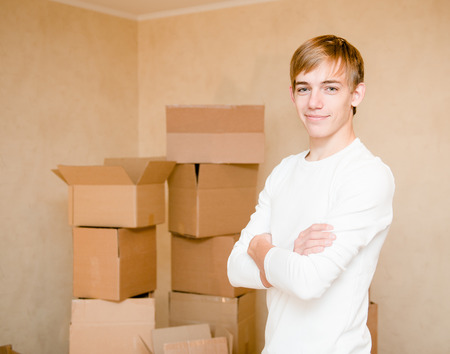 porter house: pretty young boy standing on a background of cardboard Stock Photo