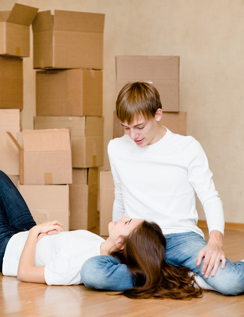 young couple in new home photo
