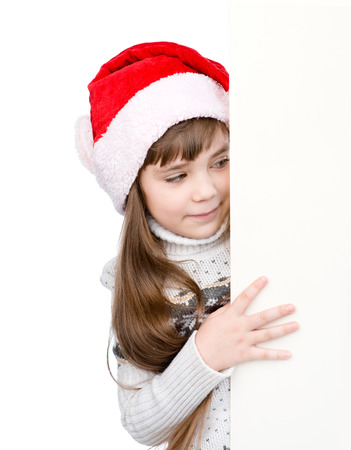 Christmas girl in santa helper hat with blank white board. isolated on white background photo