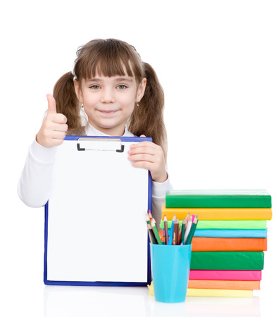 child holding sign: young girl holding clipboard with an empty document and showing thumb up Stock Photo