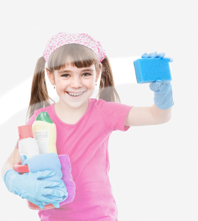 Funny little housewife cleaning window Stock Photo