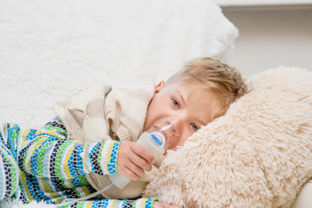 inhalation: sick little boy makes inhalation home