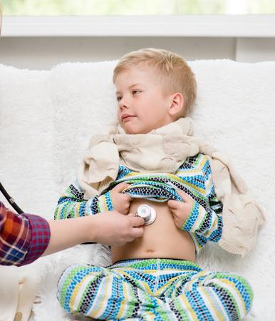 stethoscope boy: mother examining boy with stethoscope