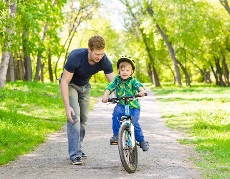 weekend activity: father and son having fun weekend biking