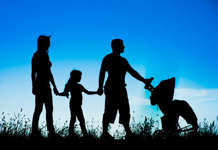 family outside: silhouette happy family Stock Photo