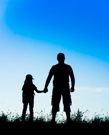 father daughter: silhouette father and daughter holding hands. Stock Photo