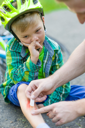 bandaid: child with an injury from a fall from a bicycle