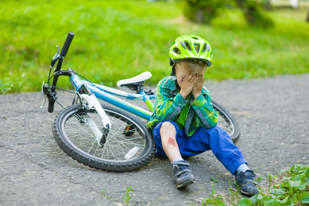 a wound: crying child that had fallen from a bicycle Stock Photo