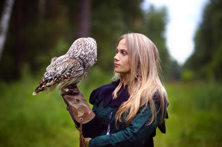 the renaissance: beautiful girl with an owl. Stock Photo