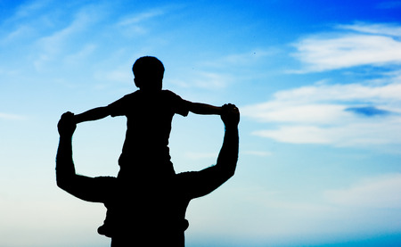 holdings: silhouette father and son. Stock Photo