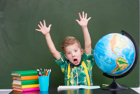 mischief: Boy indulges in class. Stock Photo