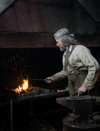 farriery: Blacksmith heats item before forging.