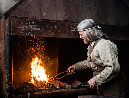 Blacksmith heats item before forging.