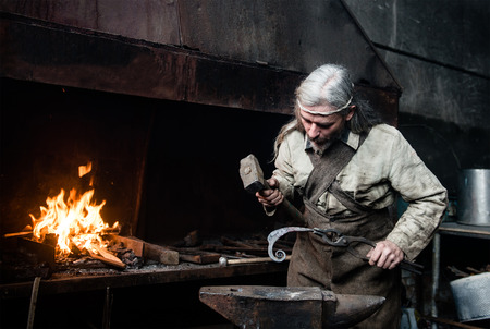 forge: Old blacksmith forge forges metal products. Stock Photo