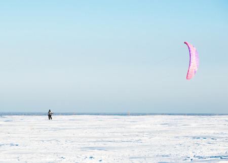 snowkiting: Kiteboarding or snow kite. Stock Photo