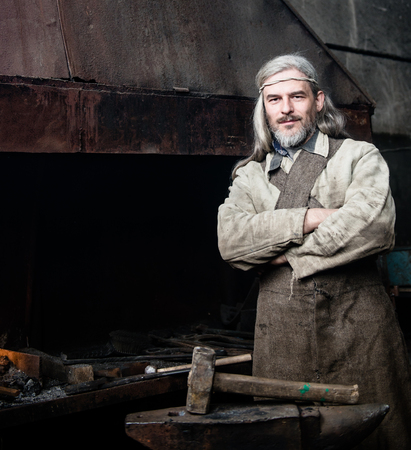 farriery: Portrait of a village blacksmith in the smithy.