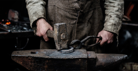 farriery: blacksmith forges item on the anvil.
