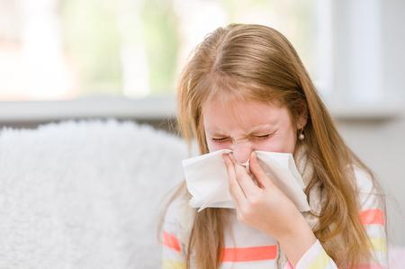 Teen girl blowing her nose. 写真素材