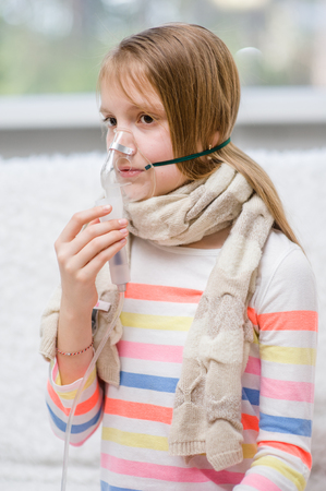 Teen girl with a mask for inhalations.