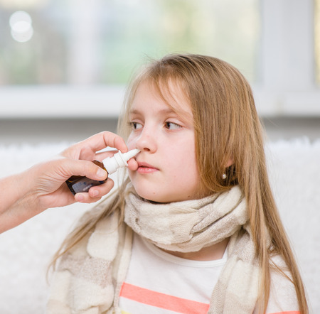 rheum: Mother using nose spray to cure her teen girl.