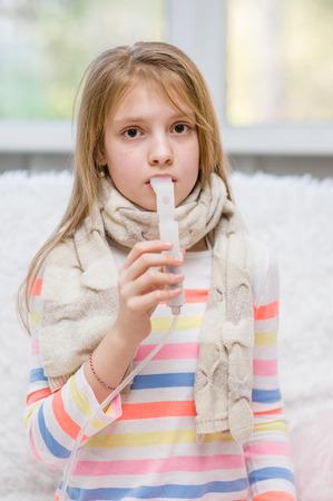 inhaler: Sick girl with inhaler.