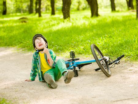 blood sport: Boy fell from the bike in a park.