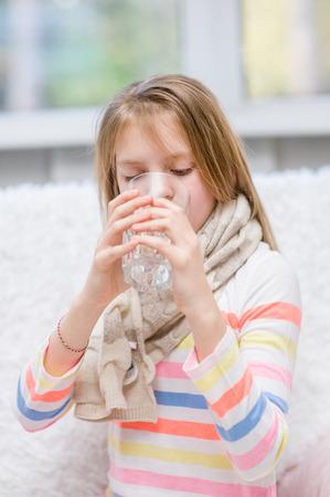 diseased: Diseased girl drinks water.