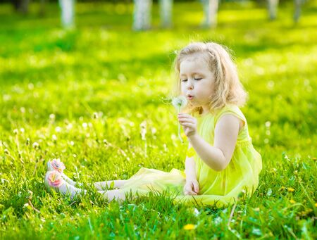 blowing dandelion: Cute little girl blowing dandelion.