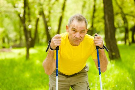 nordic walking: Tired elderly people engaged in Nordic walking.
