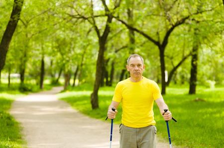 nordic walking: Elderly people engaged in Nordic walking. Stock Photo