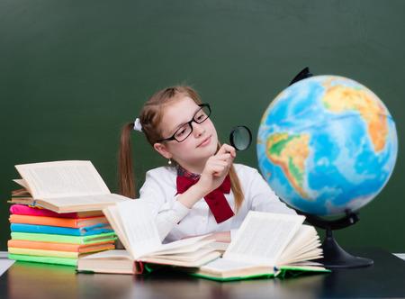 exploring: Young girl exploring the globe.