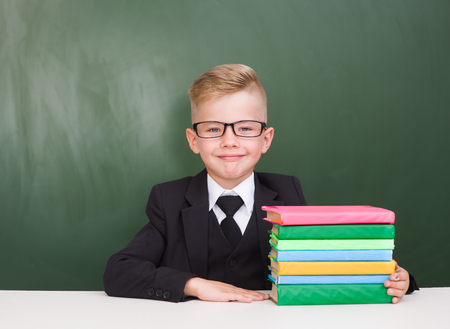 schoolboy: Portrait of a happy schoolboy with books.