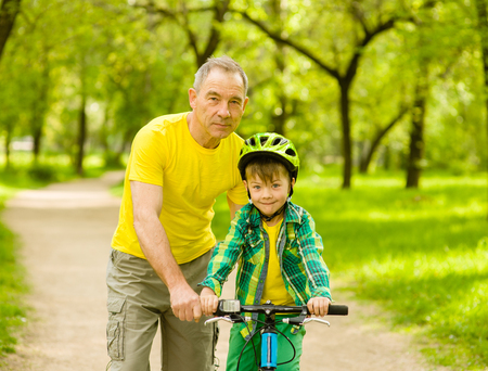 Portrait of father and son with a bicycle.
